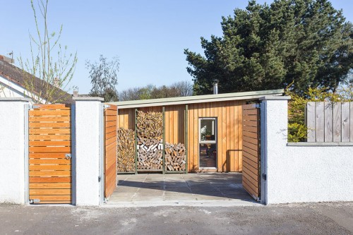 Wooden Gates and log store